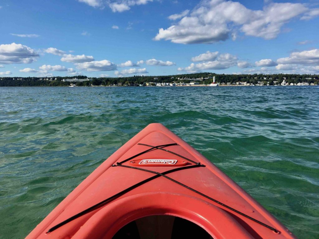 Kayaking on Lake Huron with the Mackinac Island in the distance.