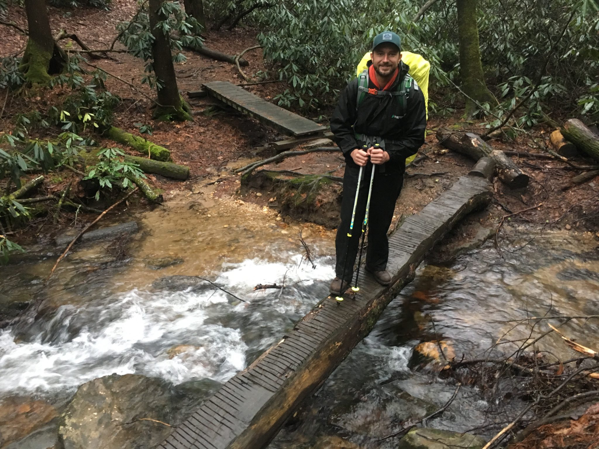 Michael crossing a stream, roaring from the rain