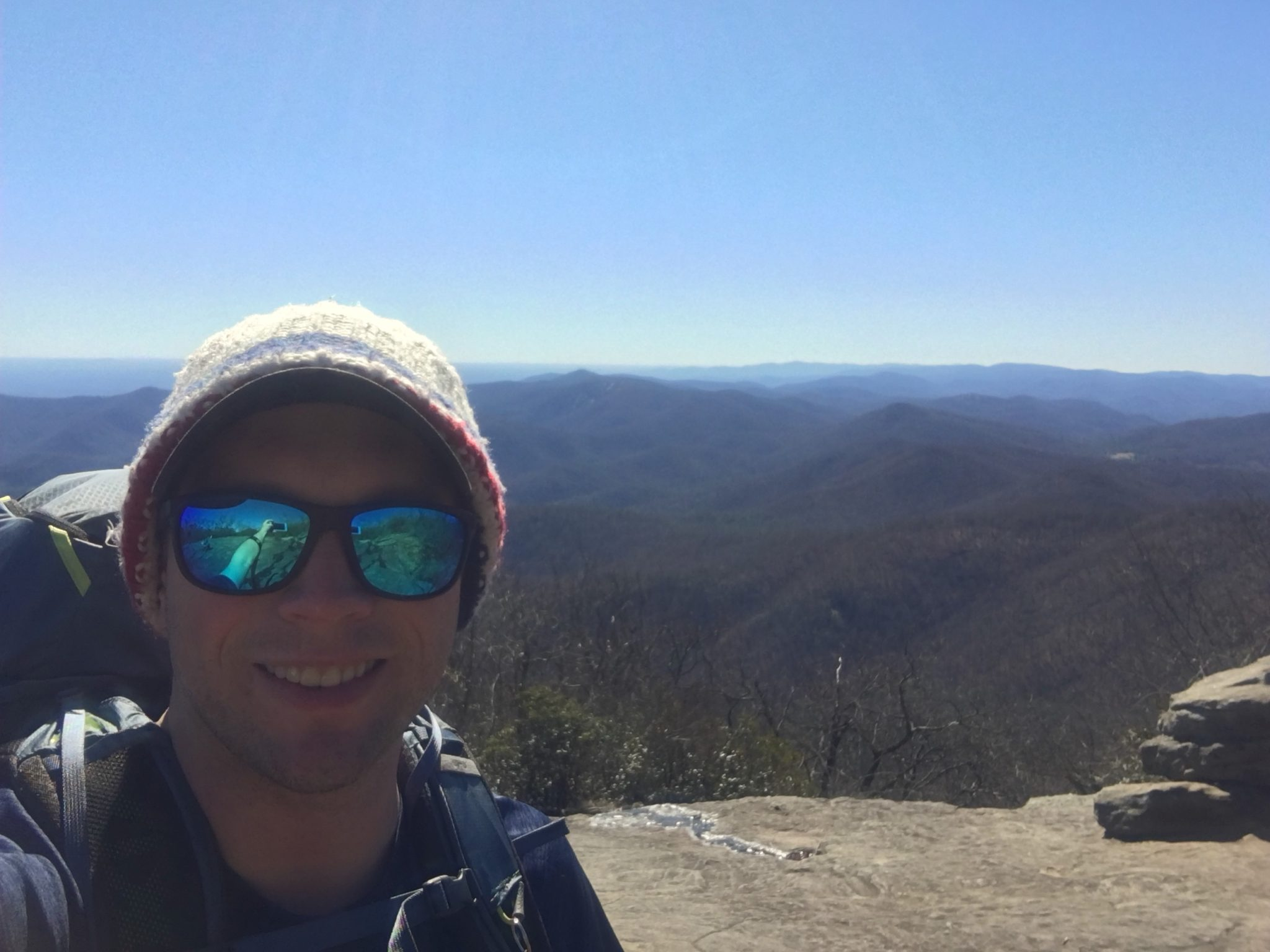 Smiling through the pain on top of Blood Mountain