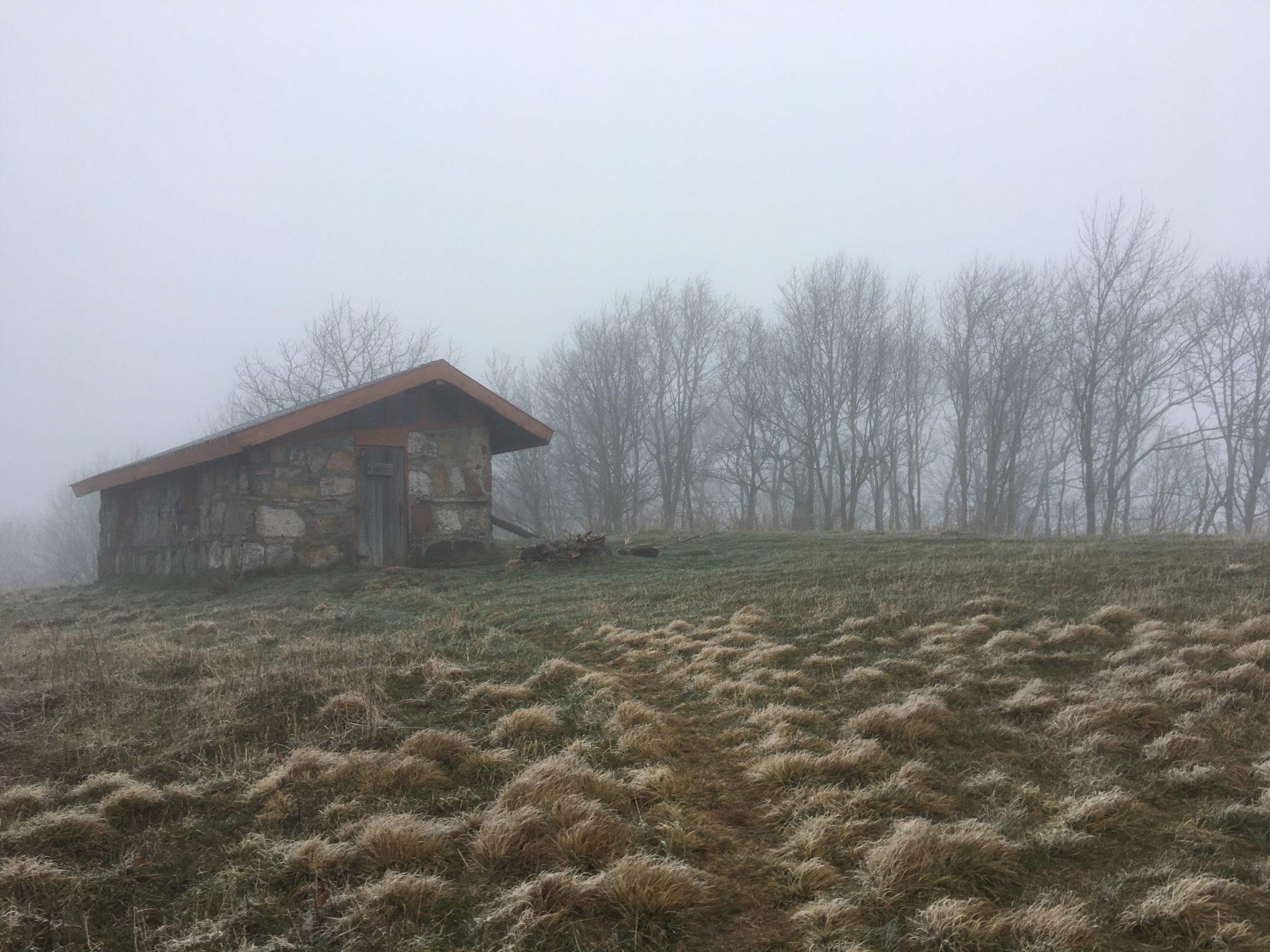 Chestnut Knob Shelter in the eerie fog