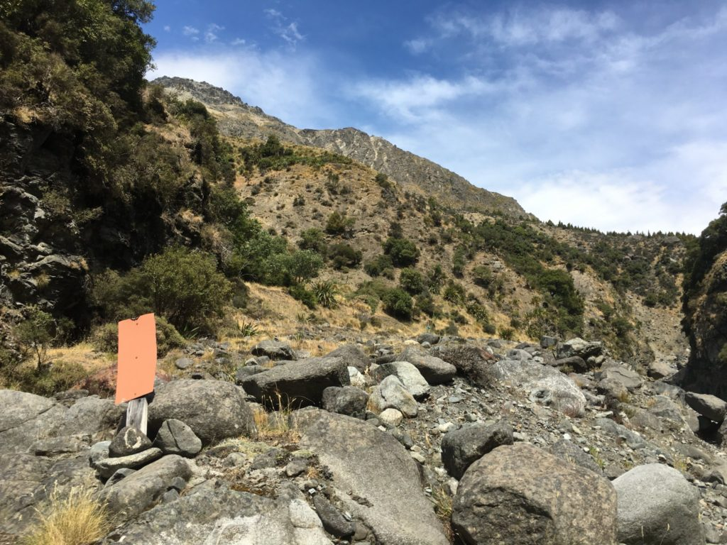 Orange sign indicated the trail leaves the riverbed and heads up the hillside