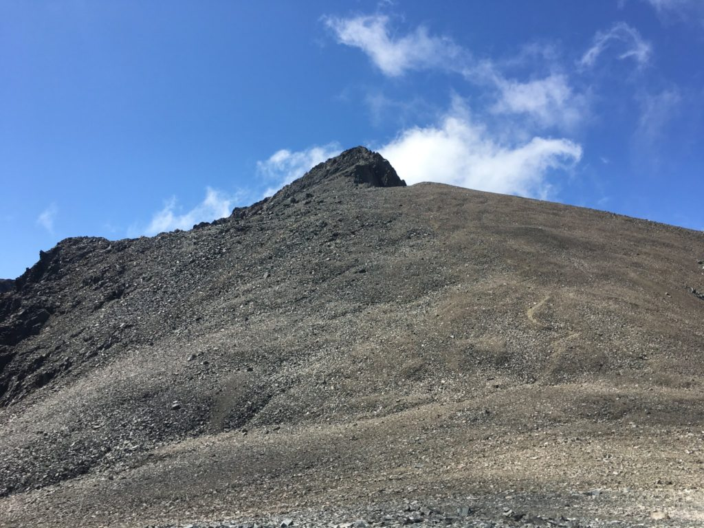 The trail switchbacks up the rock scree before the final ridge to the summit
